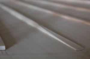 Détail de la forme de l'extrémité d'une barre de l'éventail