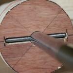 Insertion de tiges filetées dans l'axe du cylindre