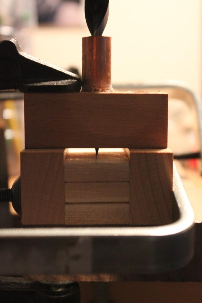Vérification du centrage des porte-douilles avec un foret de 10mm