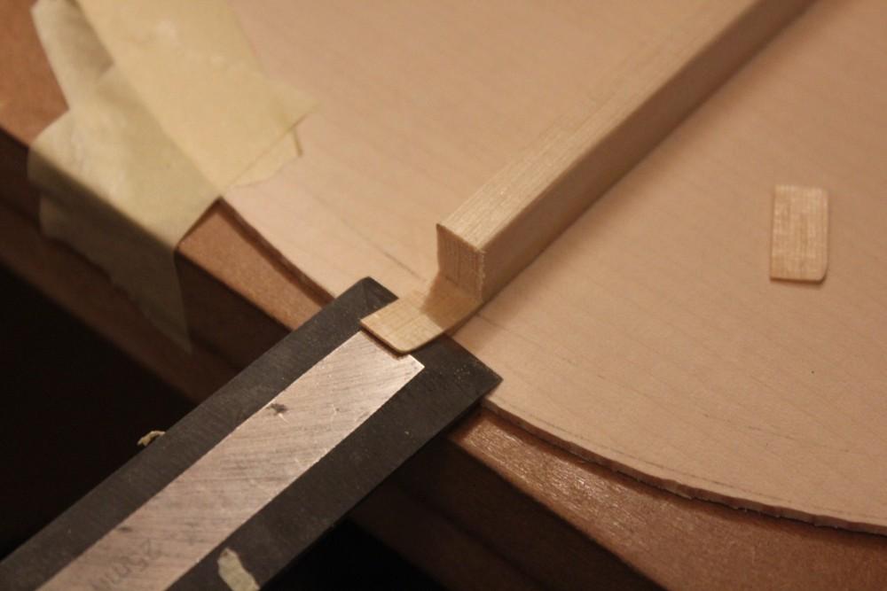 Réduction de la longueur des barres au ciseau à bois