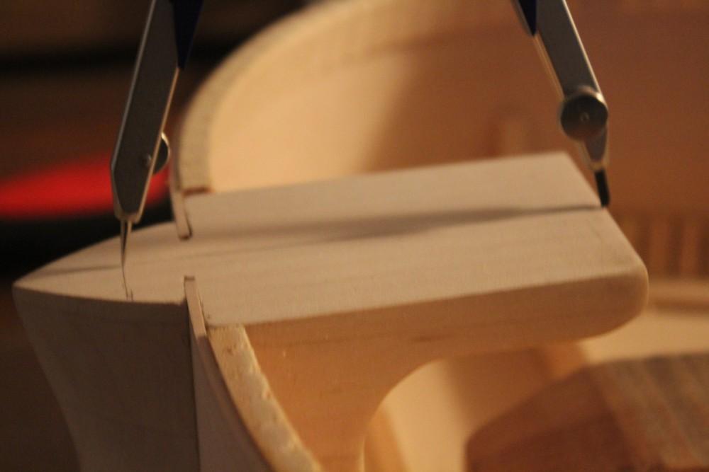 Mesure de la longueur du talon à partir du point de passage du fond