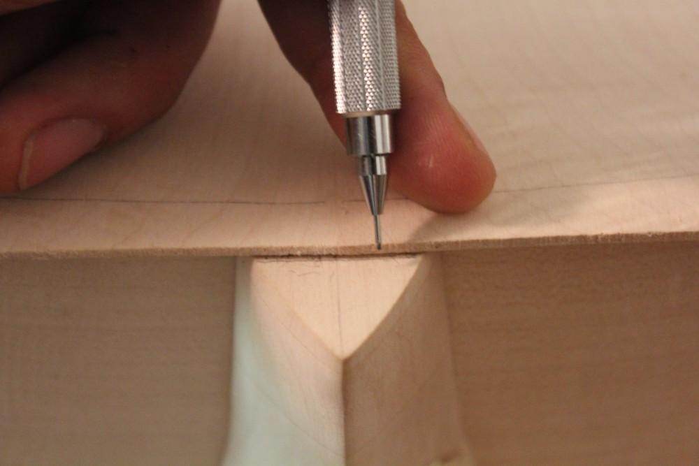 Marquage de l'extrémité du fond au niveau du talon