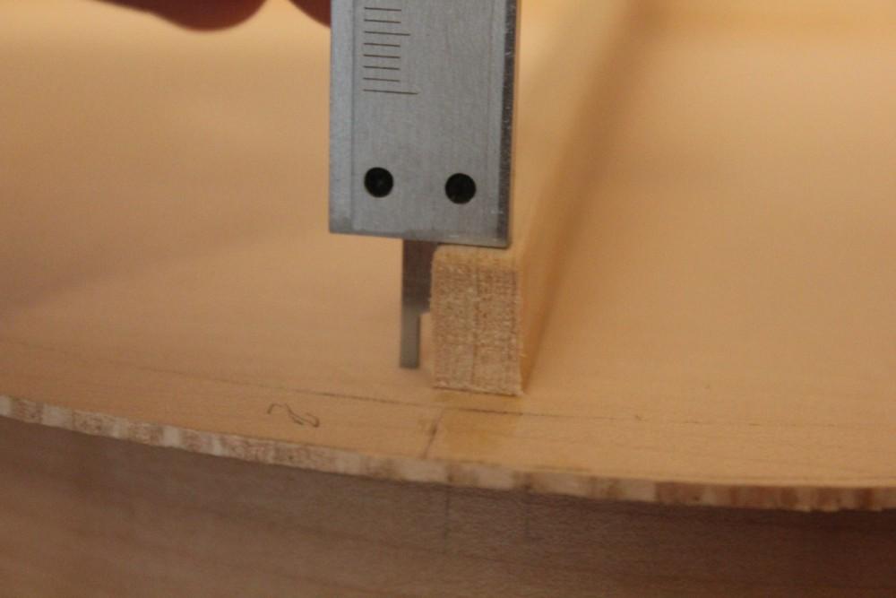 Mesure de la hauteur d'une barre à son extrémité